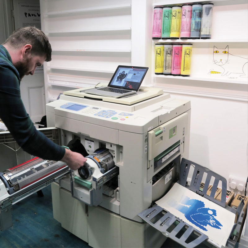 Printing begins on our Risograph machine.