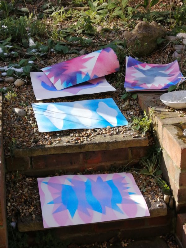 Spray painted stencils drying outside
