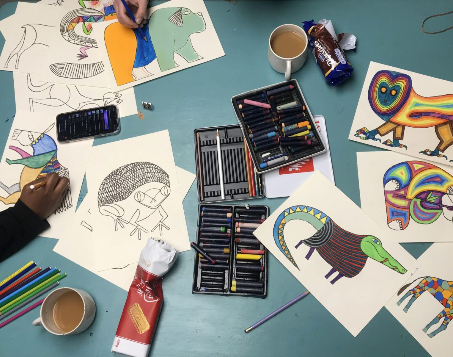 Hart Club artists colouring in pages of Animalgam.