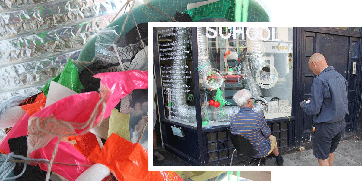Robin Whitmore and David Bassadone constructing the Hart Club window installation
