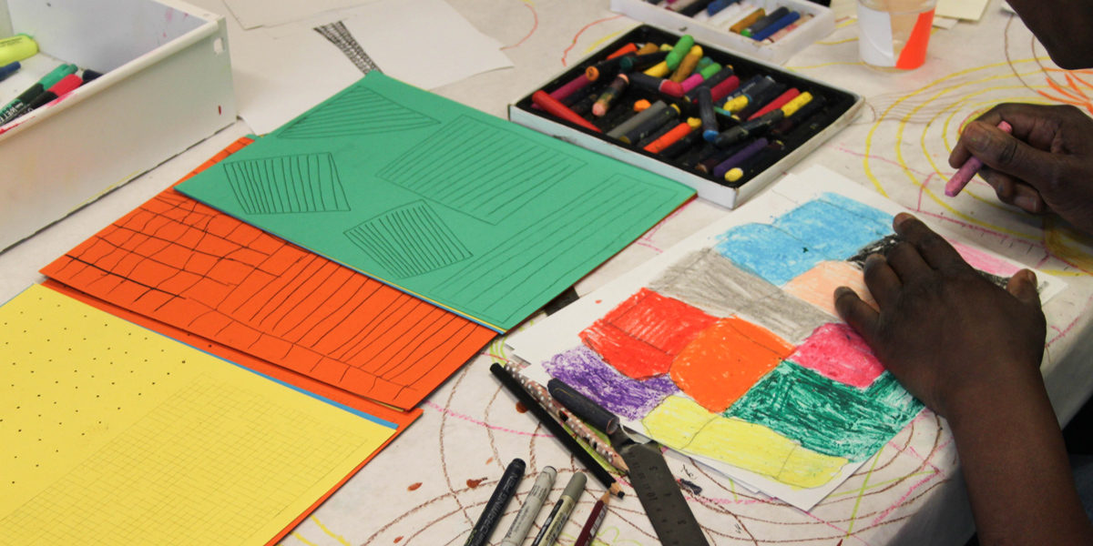 Hart School students prepare their drawings to be riso printed.