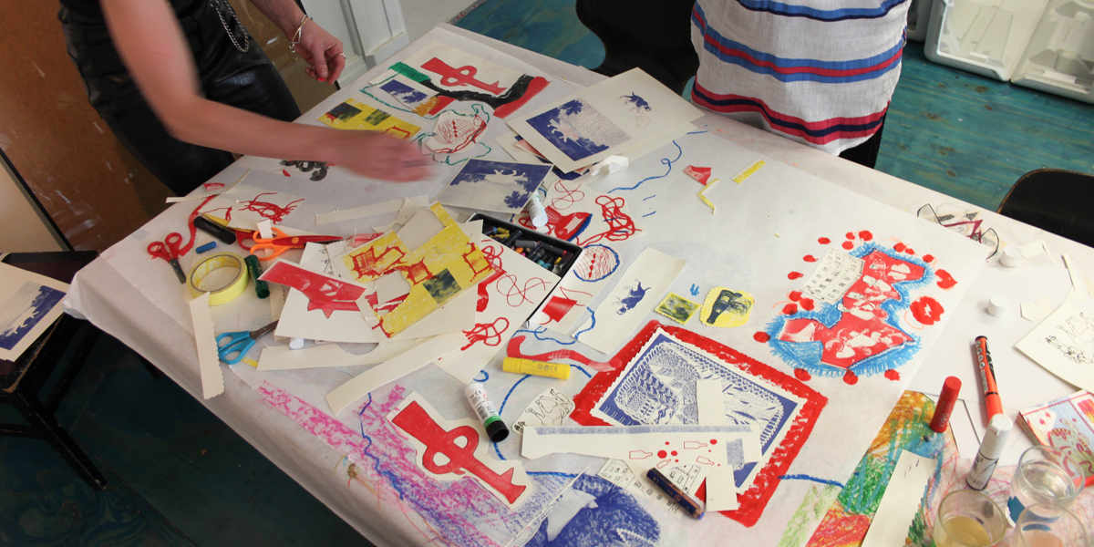 Print experiments are cut out and collaged to make a large scale collaborative piece.